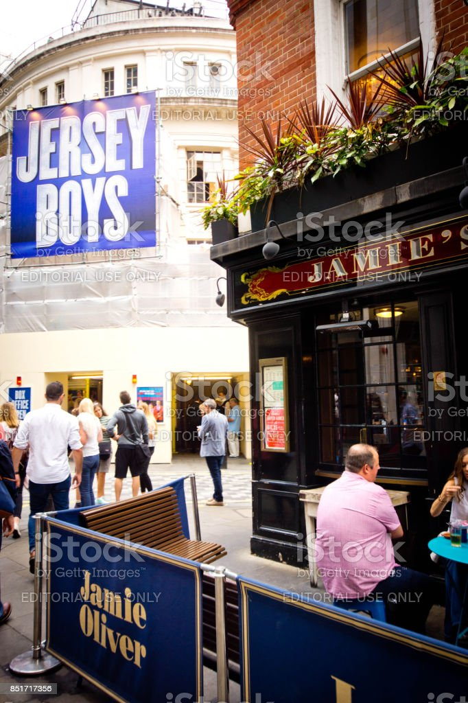 Tourists near Piccadilly Theatre stock photo