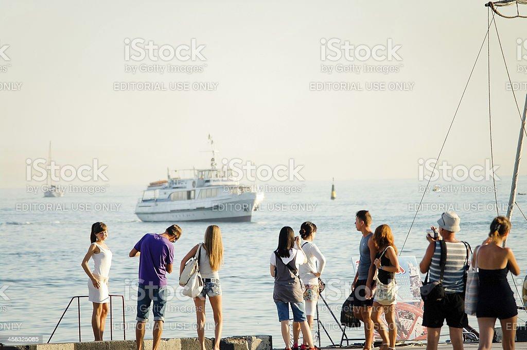 Tourists near port in Yalta, Ukraine stock photo