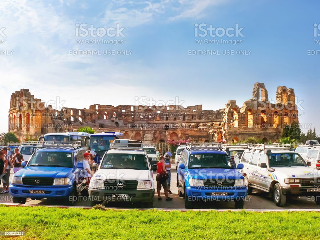 Tourists near ruins of El Djem amphitheatre, the most impressive Roman remains in Africa. UNESCO World Heritage Site. stock photo