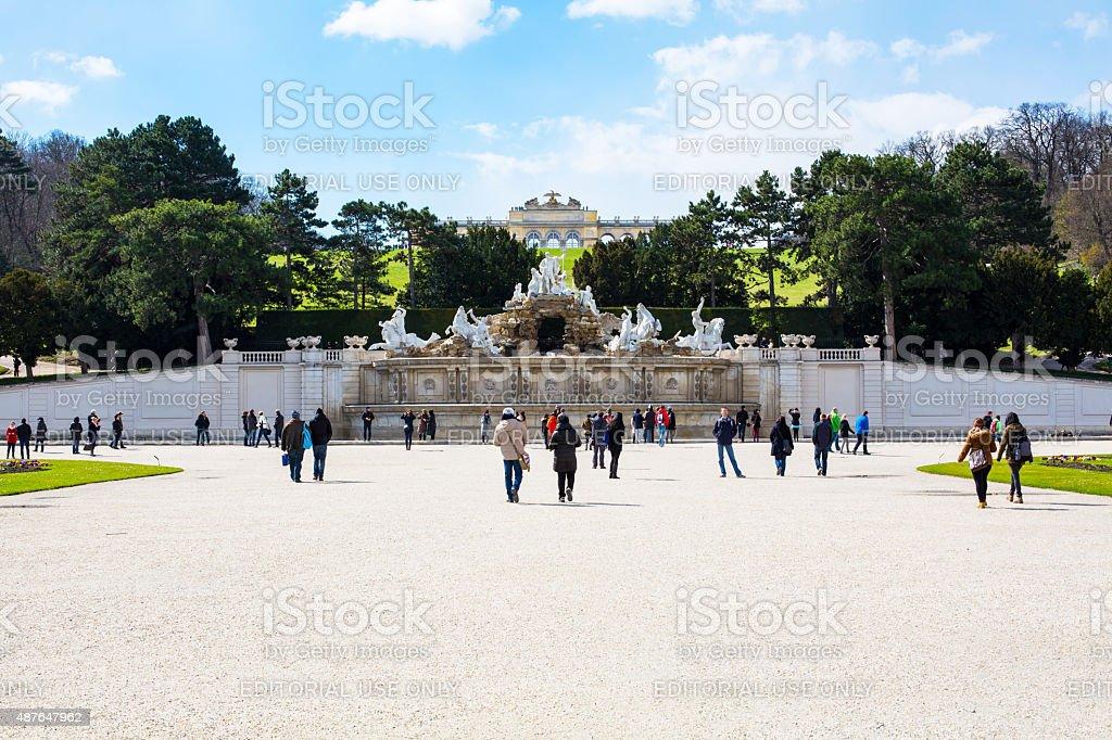 Tourists, Neptune Fountain and Gloriette at Schonbrunn, Vienna, Austria stock photo