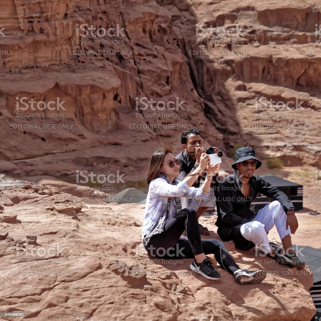 Tourists Of Different Sex And Ethnic Origin Sitting On A ...