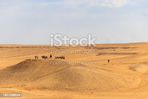 Cairo, Egypt - December 8, 2018: Tourists on a Giza plateau in Cairo, Egypt