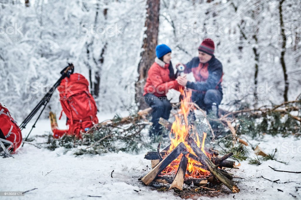 Tourists on a halt in the winter forest stock photo