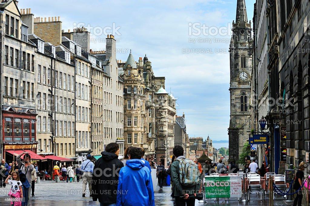 Tourists on a historic Scottish city street in Edinburgh stock photo