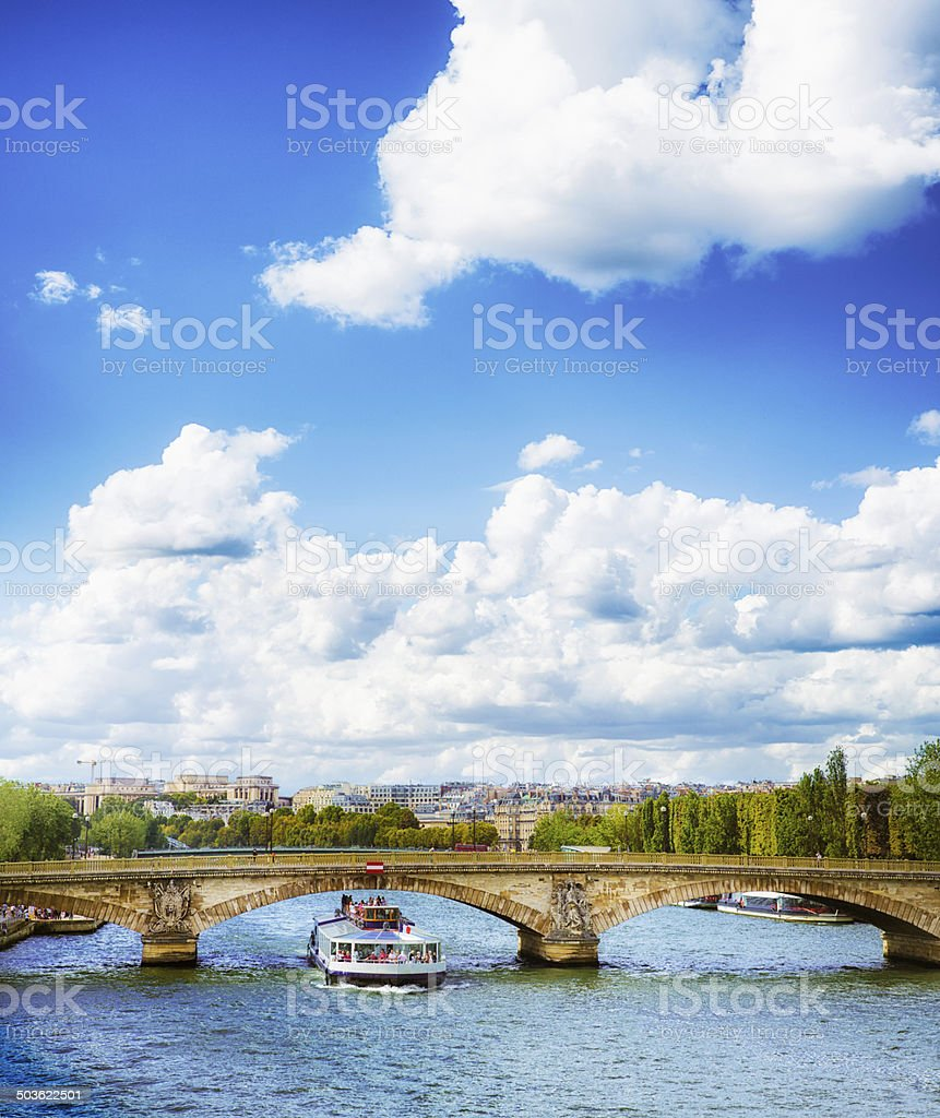 Tourists on a Seine cruise with cloudscape stock photo