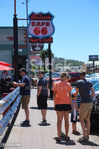 Tourists underwear the historic Route 66 sign in Williams, Arizona June 27, 2019
