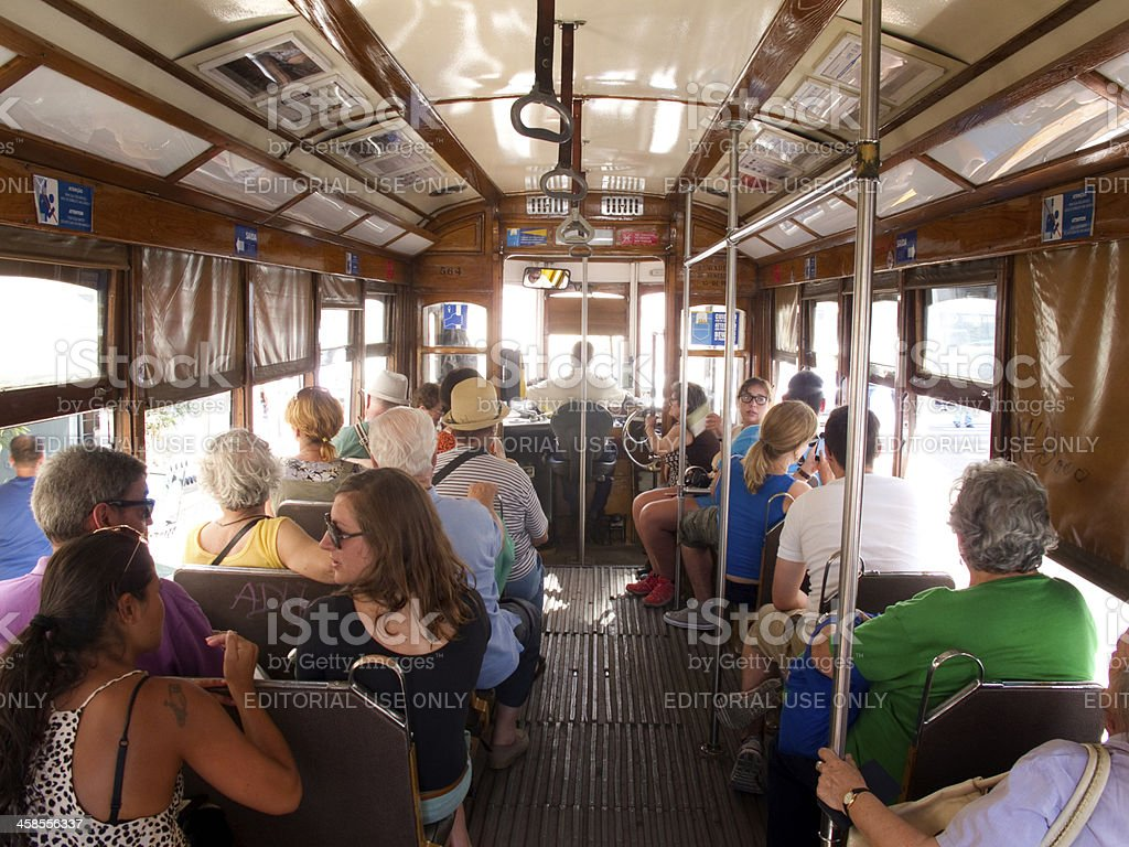 Tourists on a trolley in Lisbon Portugal royalty-free stock photo
