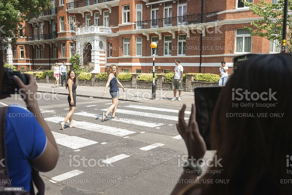 Tourists on Abbey Road, London. stock photo