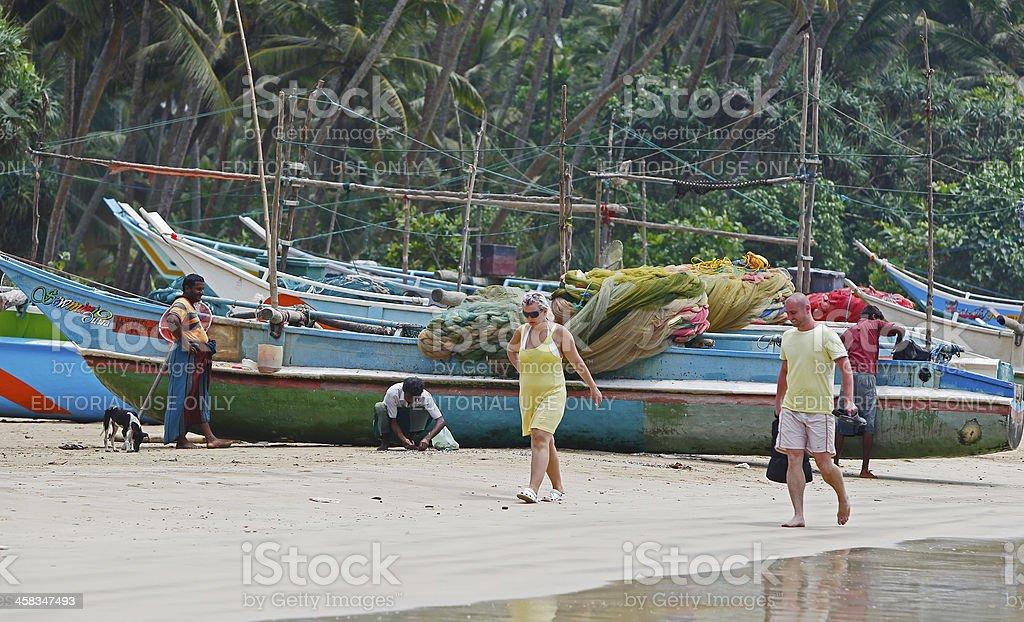 Tourists on beach royalty-free stock photo