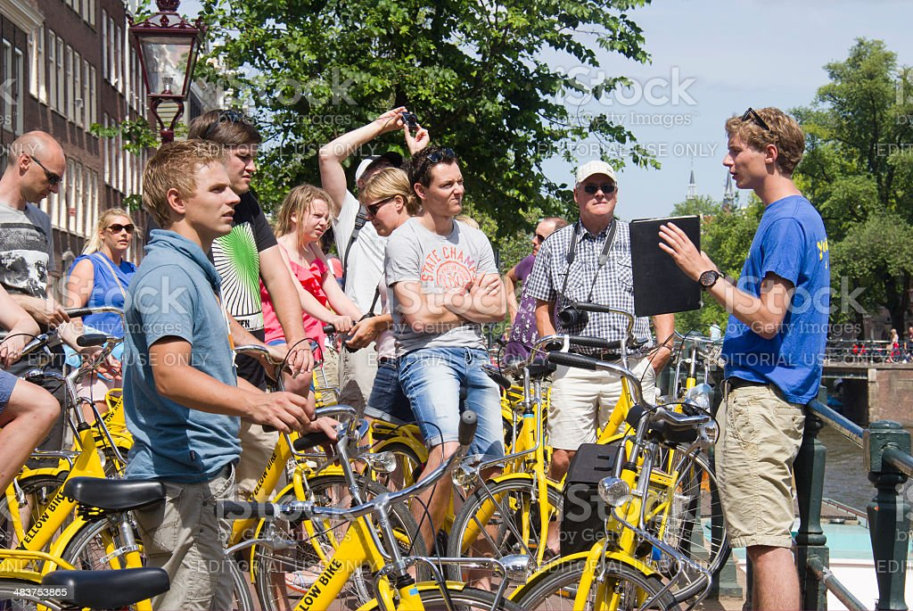 Tourists on bikes in Amsterdam stock photo