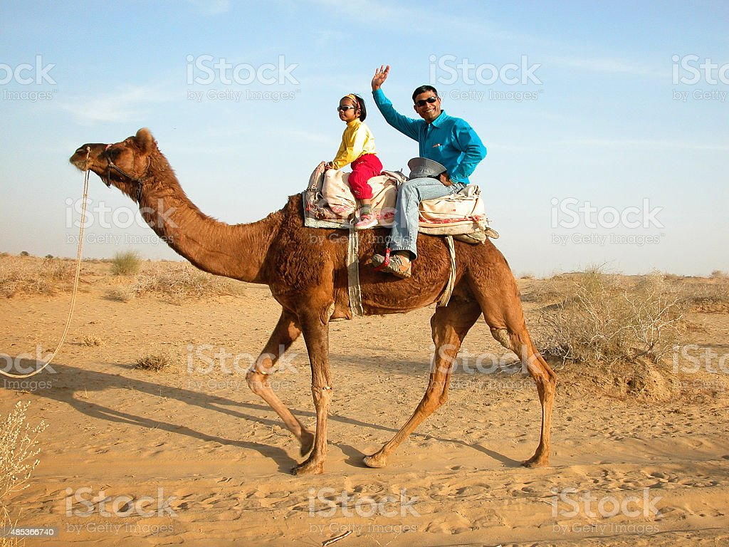 Tourists on camel in the Thar Desert of Rajasthan India stock photo