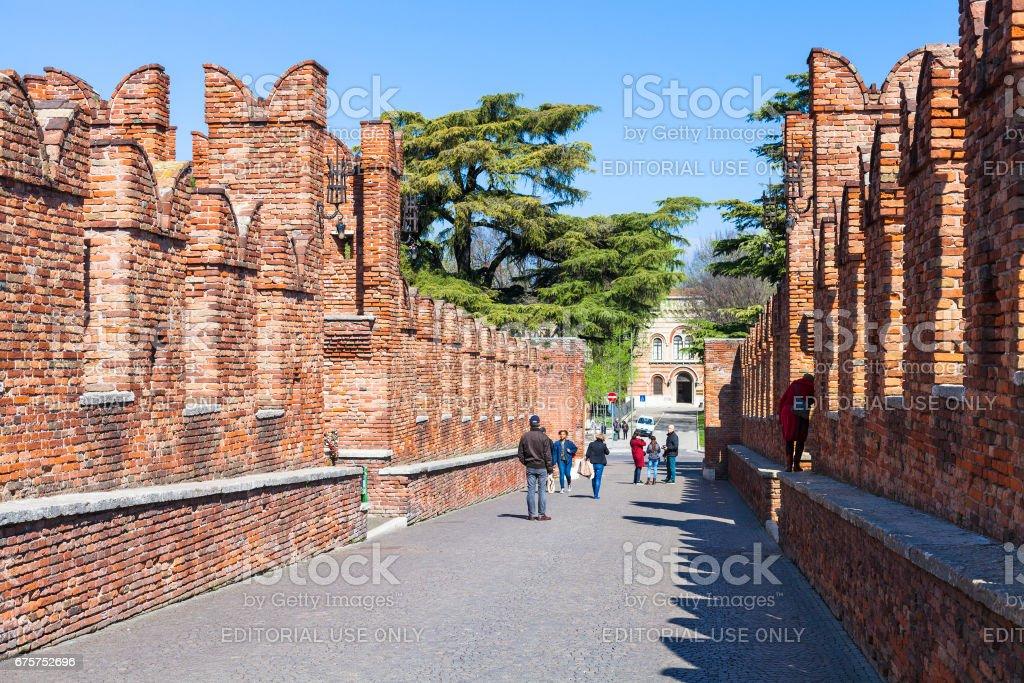 tourists on Castelvecchio Bridge in Verona stock photo