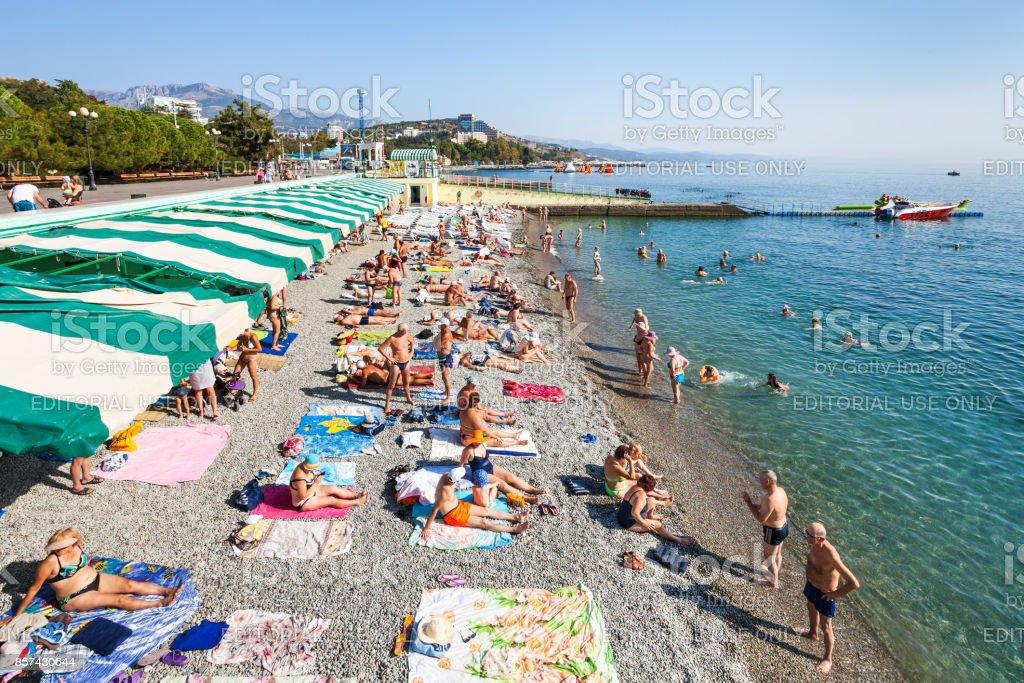 tourists on coast of Black Sea in Alushta city stock photo
