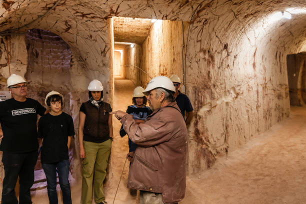Tourists on excursion in opal mine stock photo