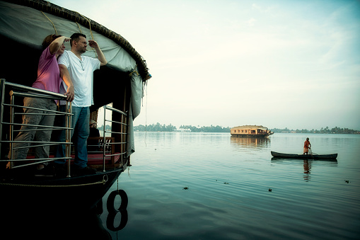 A couple from Hungary enjoying an early morning on houseboat in Southern India. Kerala Backwaters