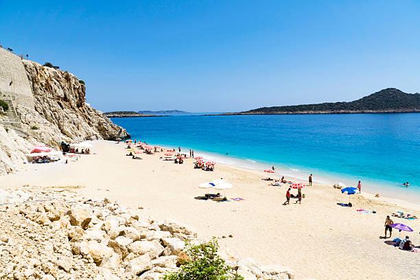 Tourists on Kaputas beach (Kaputash beach) near Kas city in Turkey ストックフォト