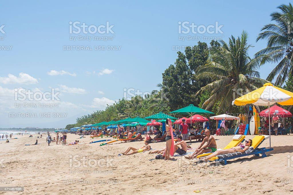 Tourists on Kuta Beach Bali Indonesia stock photo