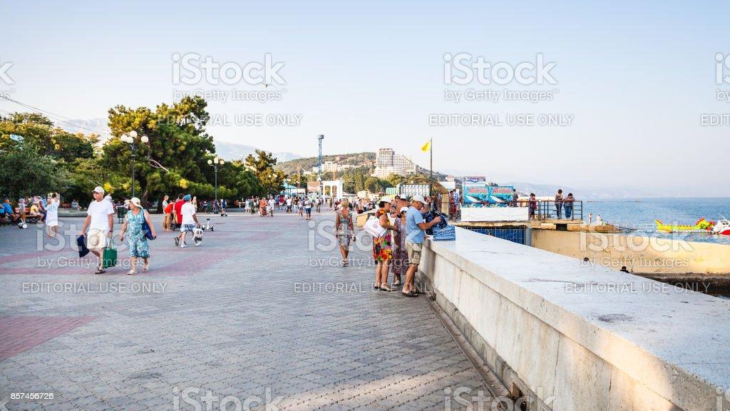 tourists on Lenin Street Embankment in Alushta stock photo