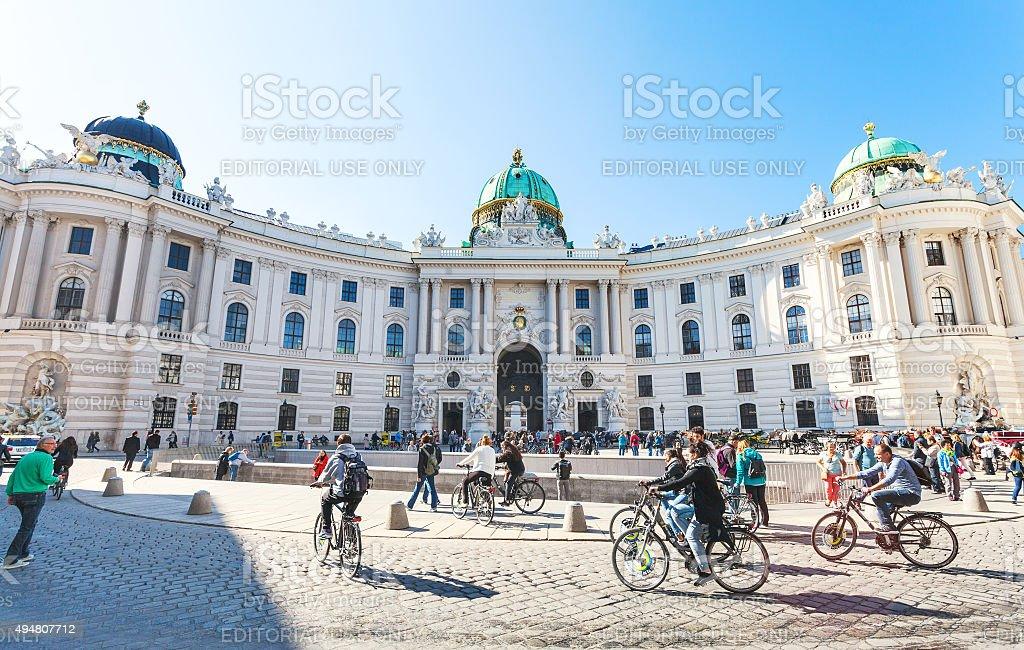 tourists on Michaelerplatz of Hofburg Palace stock photo