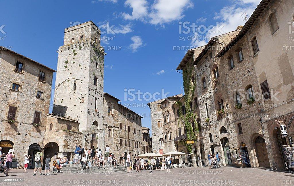 tourists on Piazza della Cisterna in San Gimignano Italy stock photo