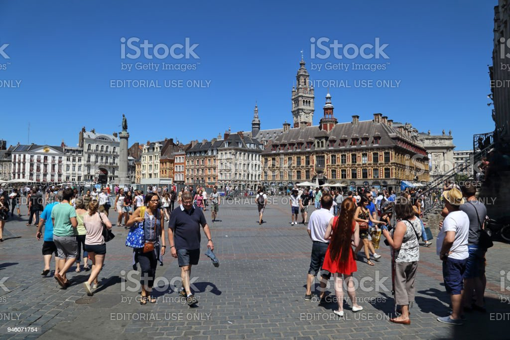Tourists on Place du General de Gaulle in Lille, France stock photo