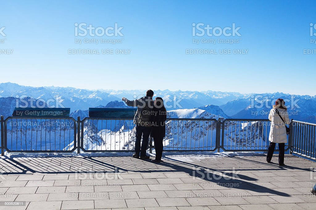 Tourists on platform of Zugspitze royalty-free stock photo