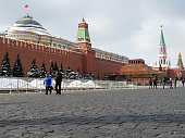 Moscow, Russia - February 2018: Red square in Moscow after snowfall. Kremlin wall, Lenin mausoleum and tourists in russian winter