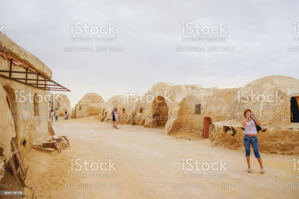 Tourists on scenery for the movie 'Star wars' near Nefta town in Tunisia. Tatooine planet industrial equipment. stock photo