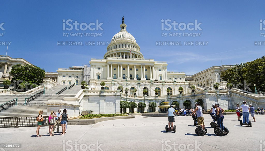 Tourists on Segway Scooters Looking at Capitol Building stock photo