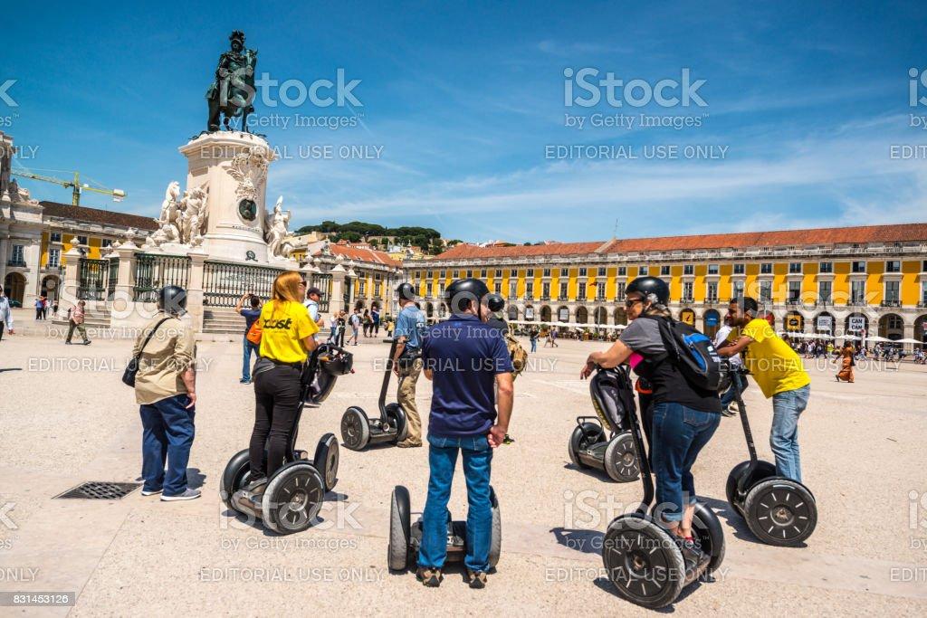 Tourists on Segways listening to their guide on Praça do Comércio, Lisbon, Portugal stock photo