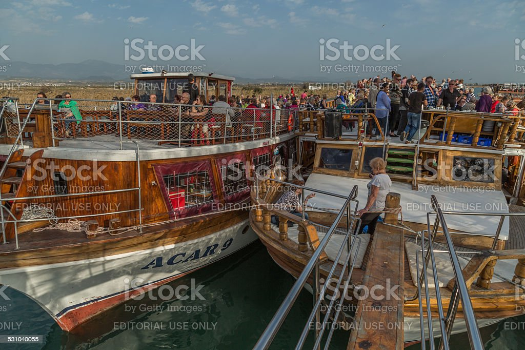 tourists on sightseeing boats stock photo