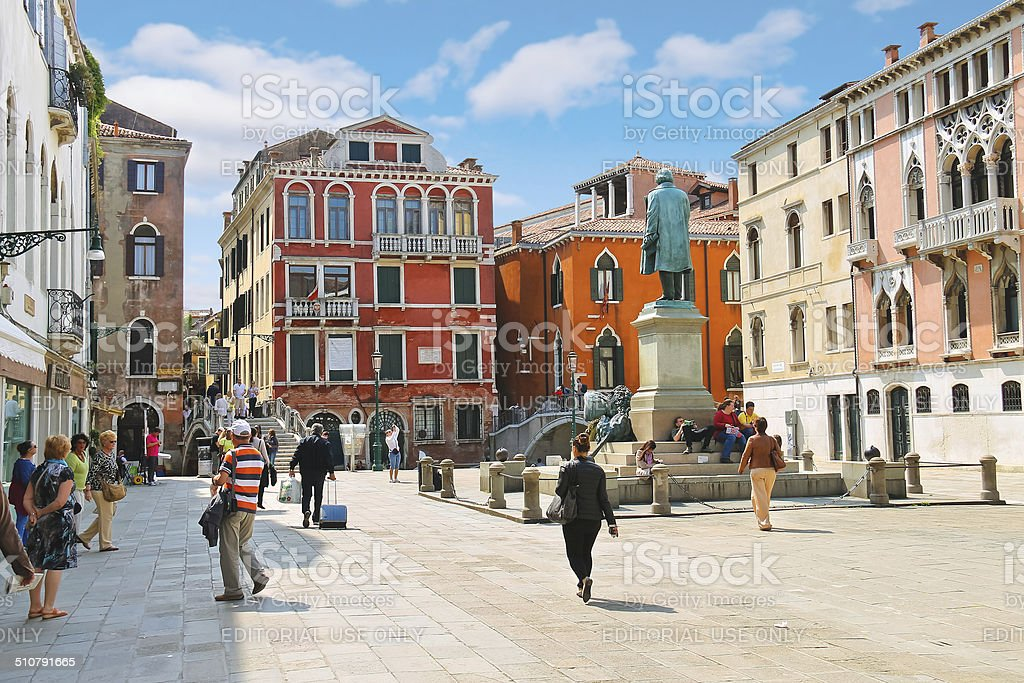 Tourists on  square near the monument Manin in Venice, Italy stock photo