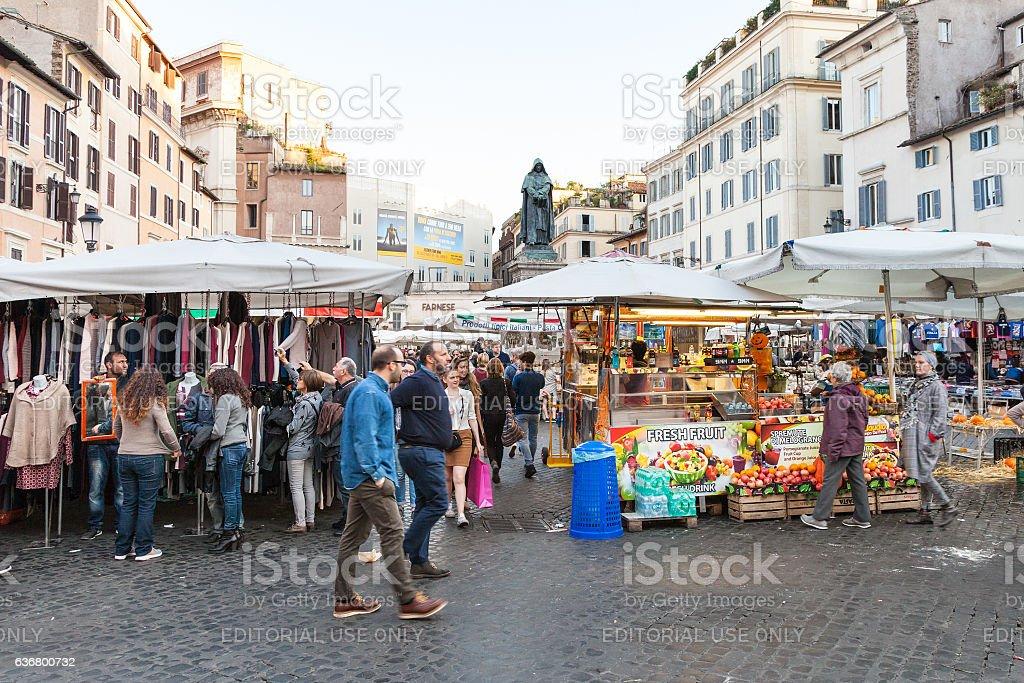 tourists on street market on square Campo de Fiori stock photo