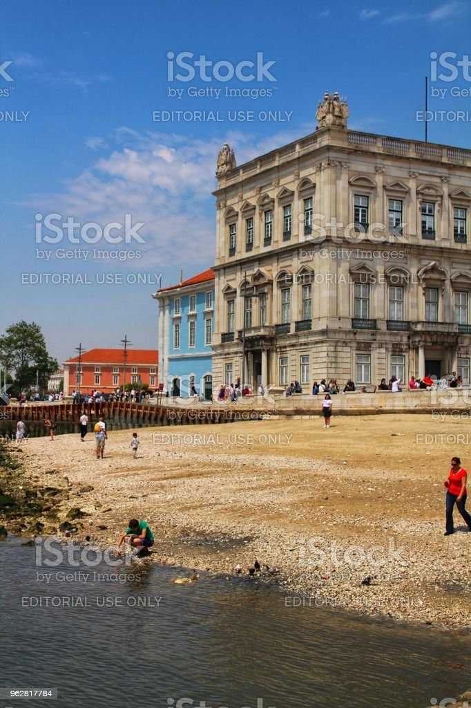 Tourists on the banks of Tagus river in Lisbon stock photo