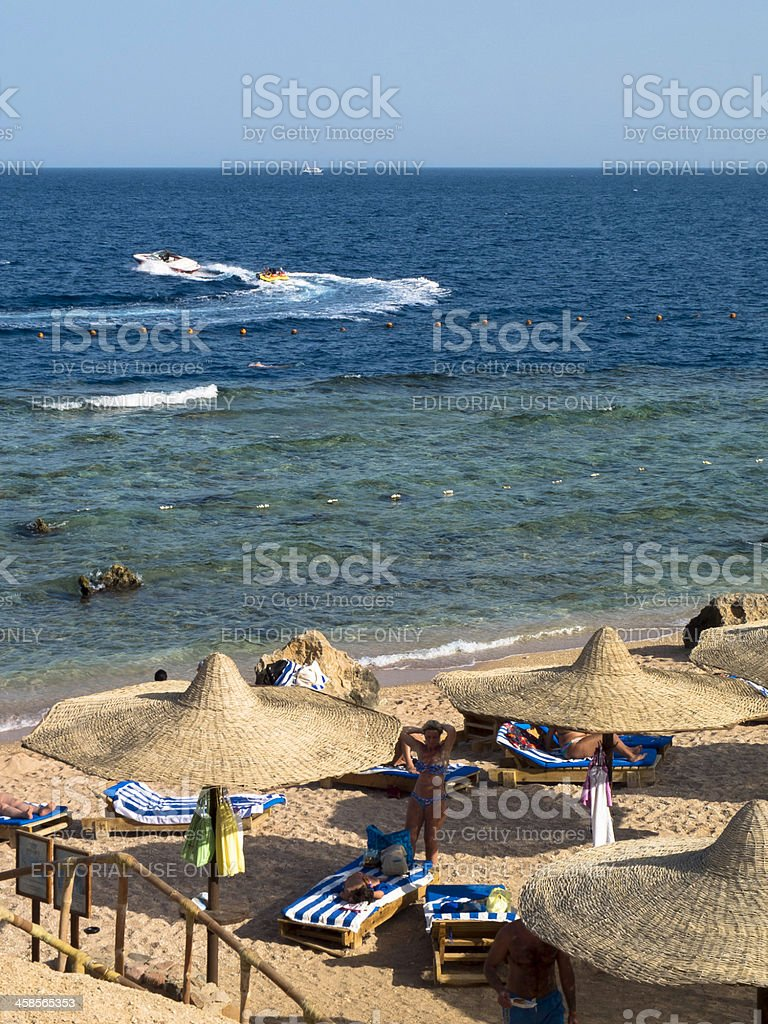 Tourists on the beach royalty-free stock photo