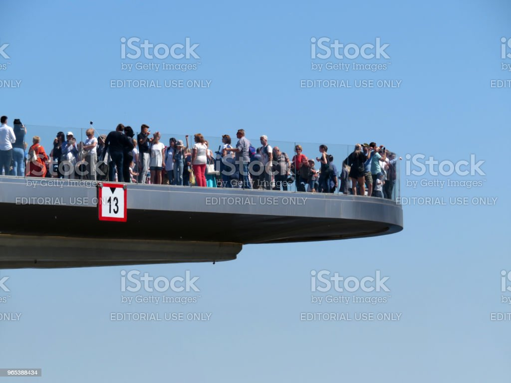 Tourists on the bridge photograph russian landmarks in Moscow royalty-free stock photo
