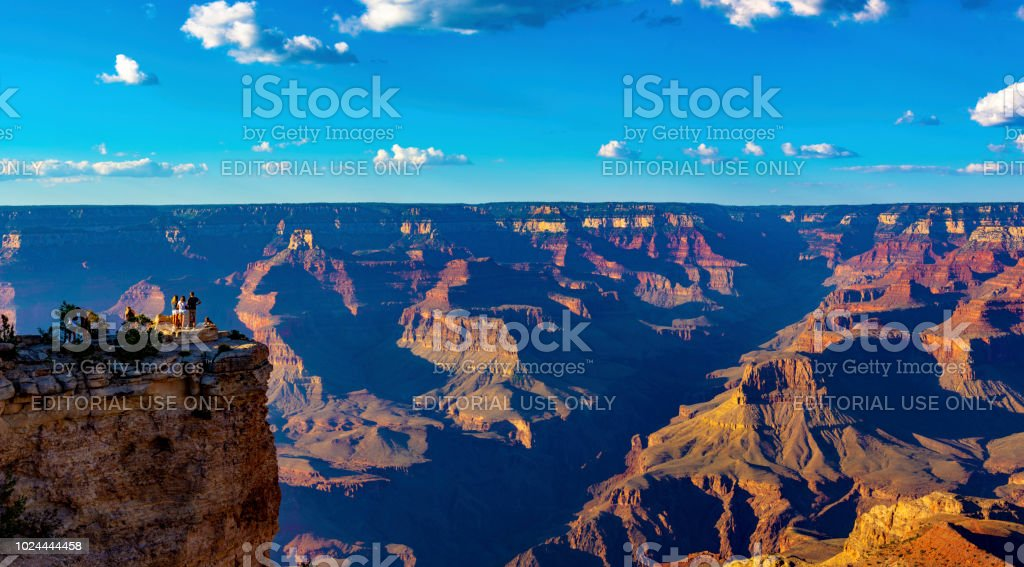 Tourists on the edge of Grand Canyon stock photo