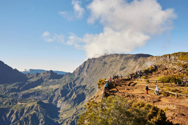 piton maido, la reunion island, france - august 15, 2017: tourists on the maido lookout overlooking cirque of mafate, listed as world heritage by unesco, la reunion island, france. - reunion stock photos and pictures