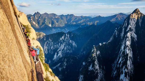 Tourists on the Plank Walk in the Sky, worlds most dangerous trail. stock photo