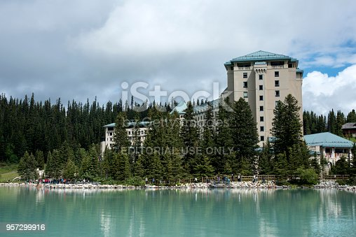 istock Tourists on the shore of Lake Louise by Fairmont Chateau Lake Louise in Banff National Park 957299916