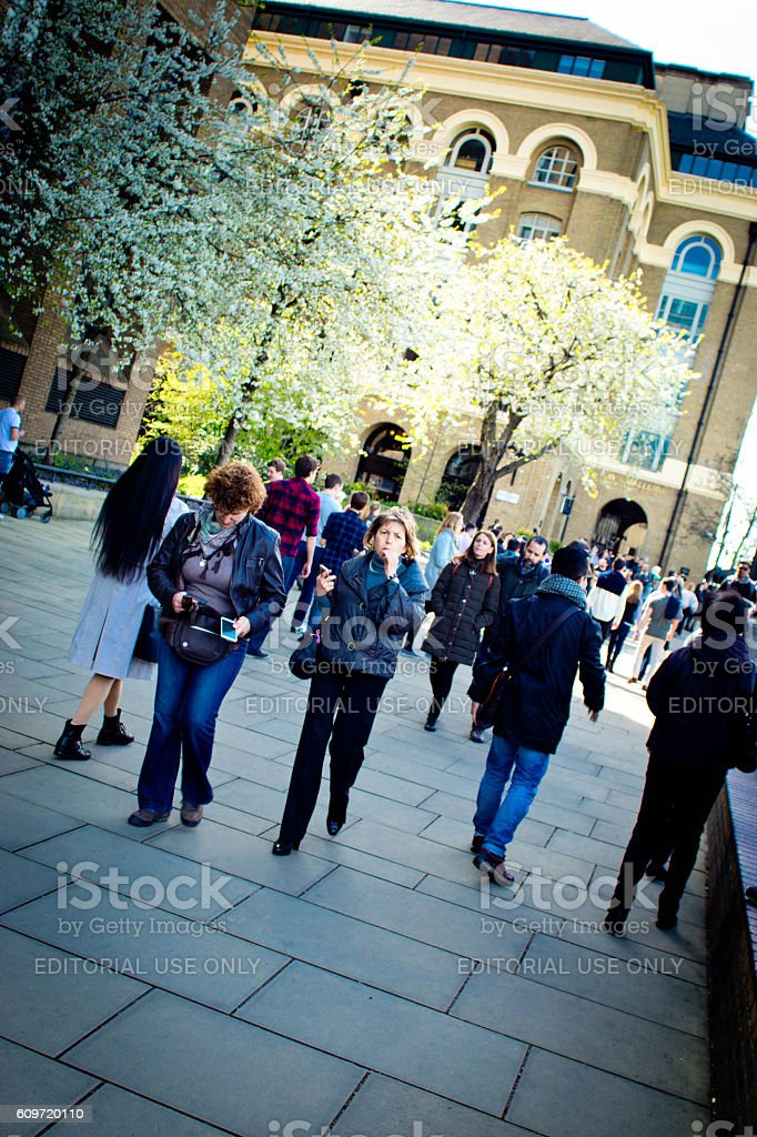 Tourists on the south bank of the Thames stock photo