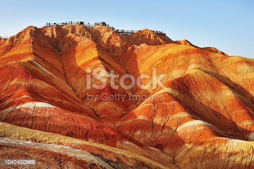 Tourists on the stand to see the beautiful scenery of Danxia landform  in the National Geopark of Zhangye, Gansu, China.
