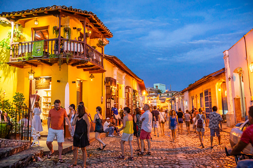 August 7, 2018 - Trinidad, Cuba: Tourists on the street in Trinidad at night, Cuba