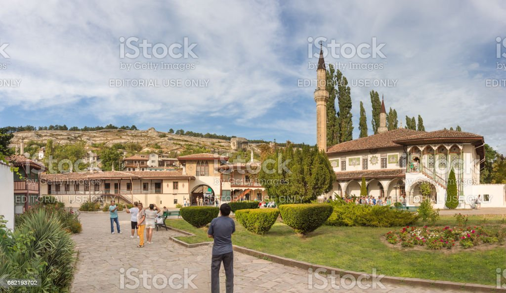 Tourists on the territory of the former residence of Crimean khans - Khan's Palace in Bakhchisarai. stock photo