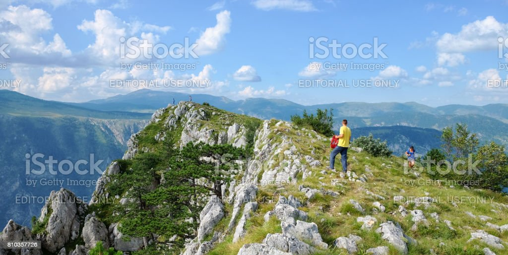 Tourists On Top Of Mount In Durmitor Park, Montenegro stock photo