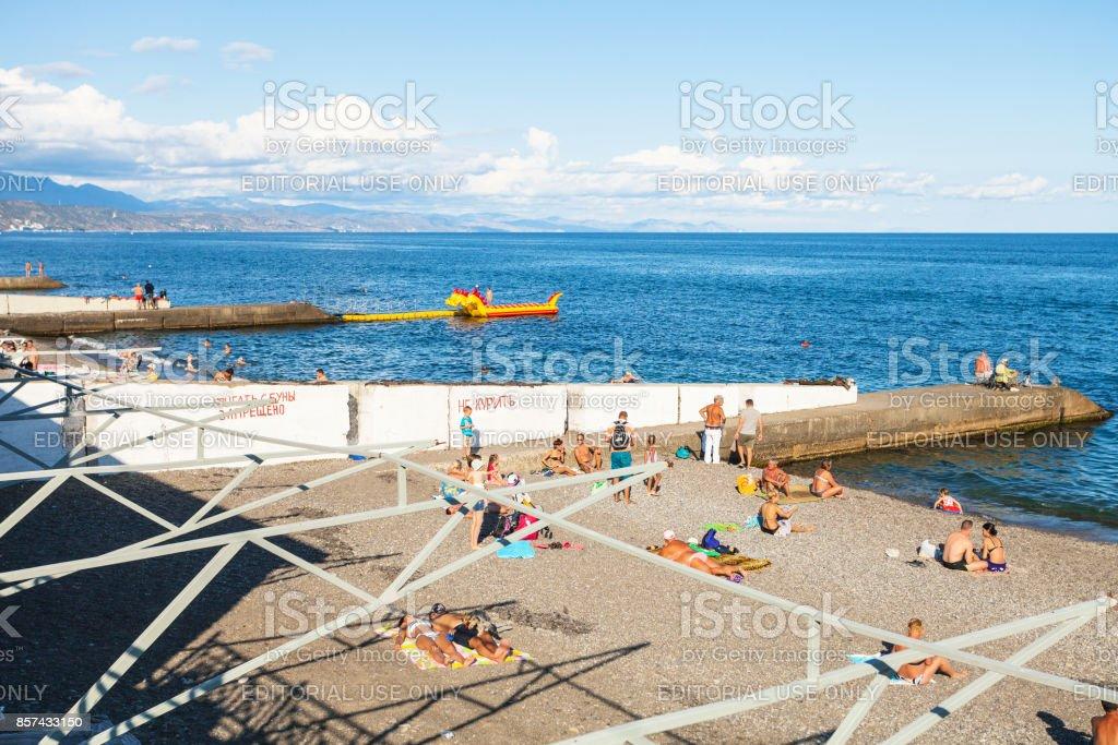 tourists on urban beach in Alushta city stock photo
