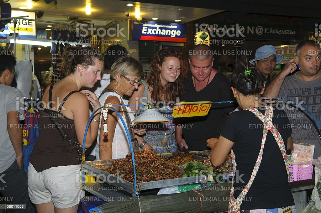 Tourists ordering fried insects on Khao San Road, Bangkok royalty-free stock photo