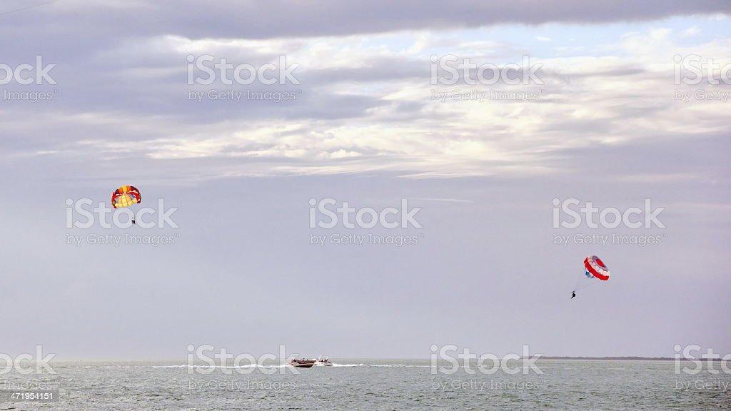 Tourists out Parasailing stock photo