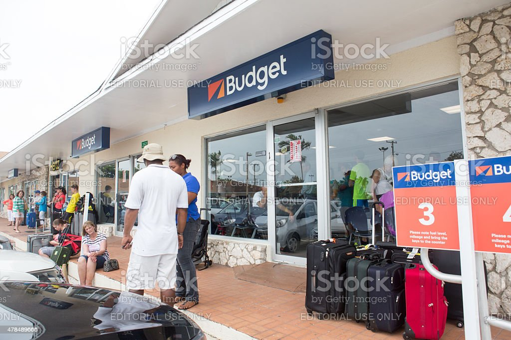 Tourists Outside Car Rental Office On Grand Cayman Island Stock Photo U0026  More Pictures Of 2015 | IStock