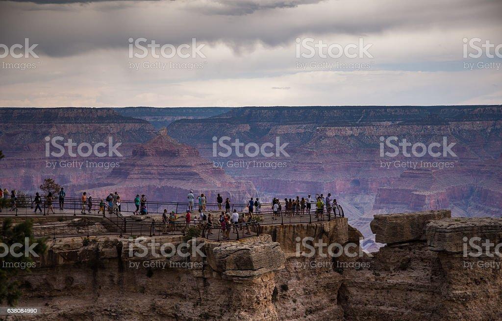 Tourists Peering into Grand Canyon stock photo